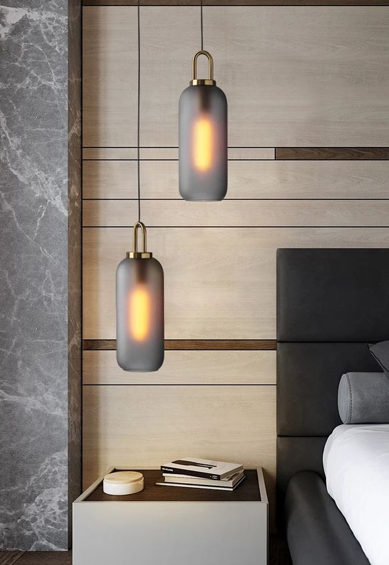 black frosted pendant lamps shaped as long jars and with copper touches for a chic look