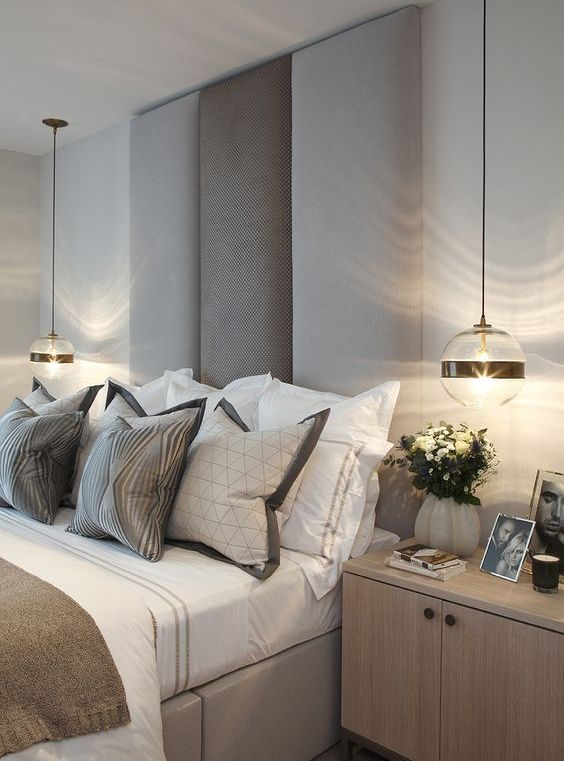 catchy glass pendant lamps with black stripes for a chic statement and touch of drama in the bedroom