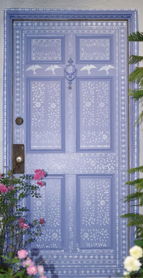 make your front door special using blue paint and white paint and stencils like here