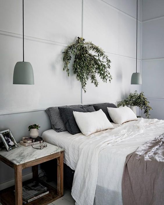 matte green pendant lamps match the neutral space and add a slight touch of color to the bedroom