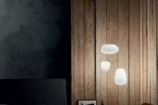 these modern floating pendant lamps remind of clouds going over the bed