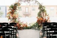 a round fall wedding arch decortaed with greenery, dried leaves and pampas grass is very chic