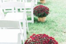 burgundy blooms in wooden baskets are amazing for lining up the aisle at a fall wedding ceremony