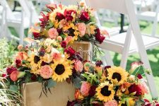 crates with bright fall blooms and foliage are great to decorate a rustic fall wedding