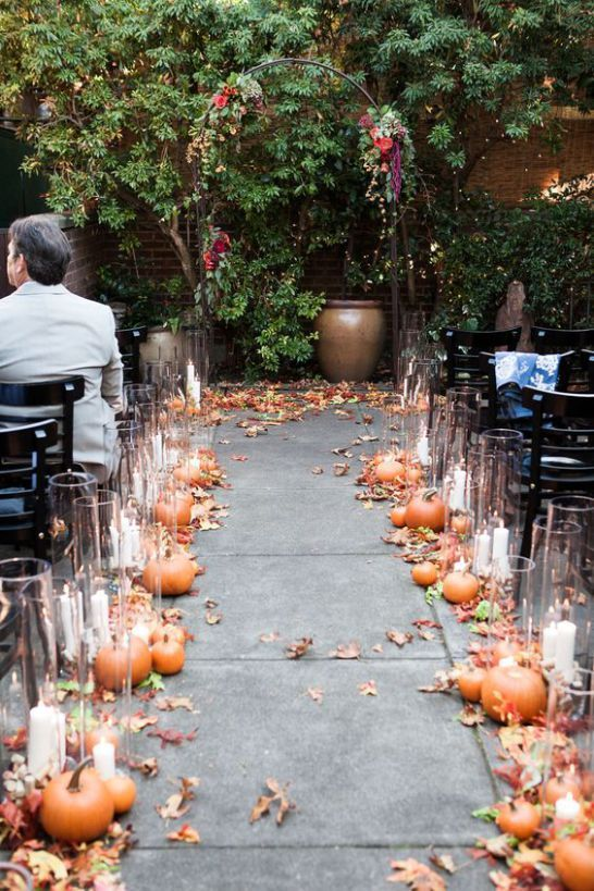 fall leaves, pumpkins with candles in glass candle holders to line up your wedding aisle outdoors