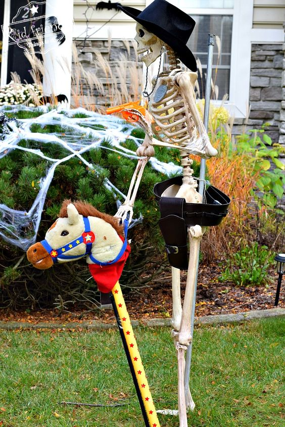 a hilarious cowboy skeleton in a hat with a fun horse is a whimsical and hilarious decoration for Halloween