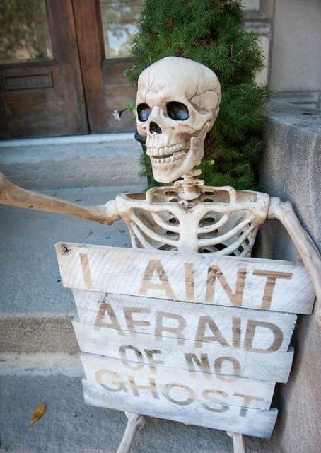 a skeleton with a sign is a nice decoration for your porch, backyard or just indoors, make one easily