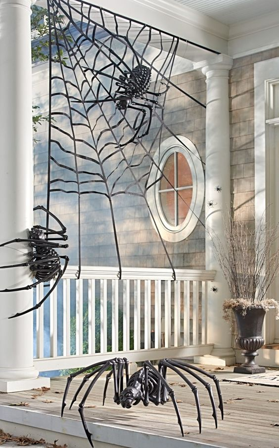 a spiderweb with skeleton spiders is a nice scene for your Halloween front porch