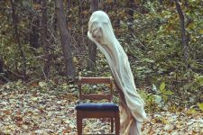 a spooky ghost over a chair is a stylish Halloween decoration to enjoy, make one easily