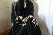an elegantly dressed skeleton with a skeleton cat is a fantastic decoration for indoors, make one fore sure