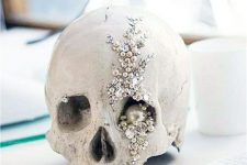 an embellished skull with beads, sequins and pearls is a nice decor idea for Halloween