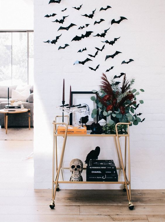 attach some bats over a fireplace or a bar cart to make it look Halloween-like