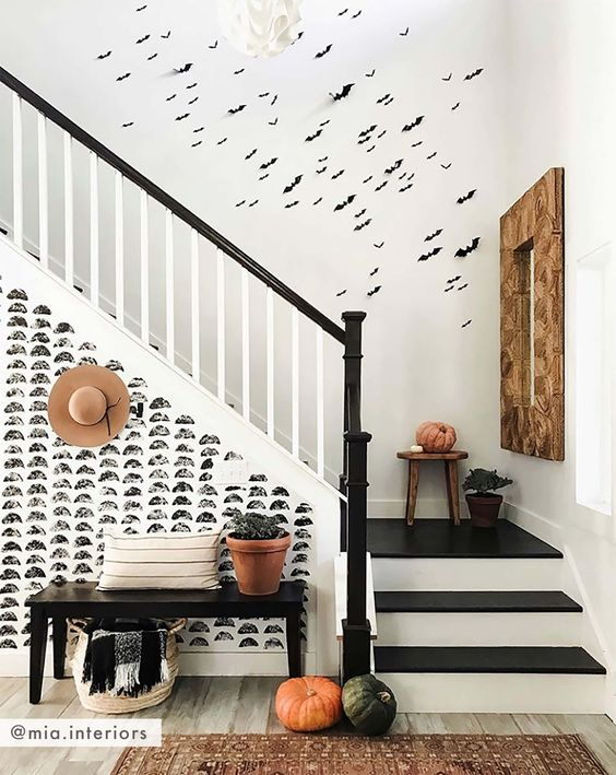 bats attached to the wall and heirloom pumpkins for all-natural and rustic Halloween decor