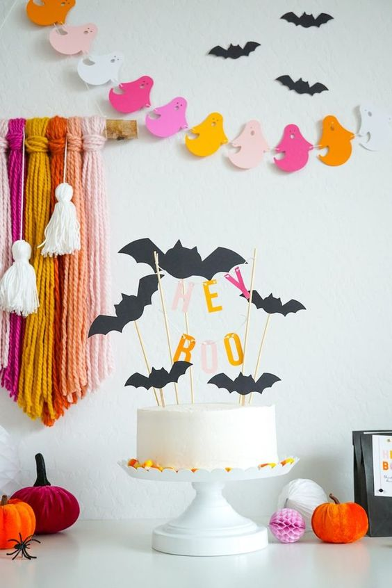 bats on the wall and bat cake toppers are nice for Halloween decor