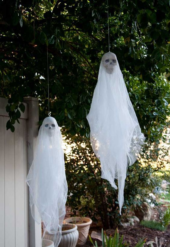 hanging ghosts with skulls are nice decorations for indoors and outdoors and can be made very fast