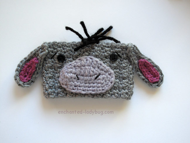 Original gray Eeyore cup cozy (via enchanted-ladybug.com)