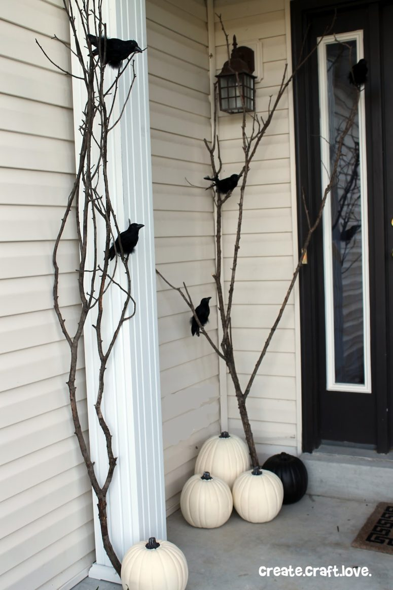 Paint some pumpkins white, add some branches painted black, add plastic ravens and you got yourself a cool Halloween porch!
