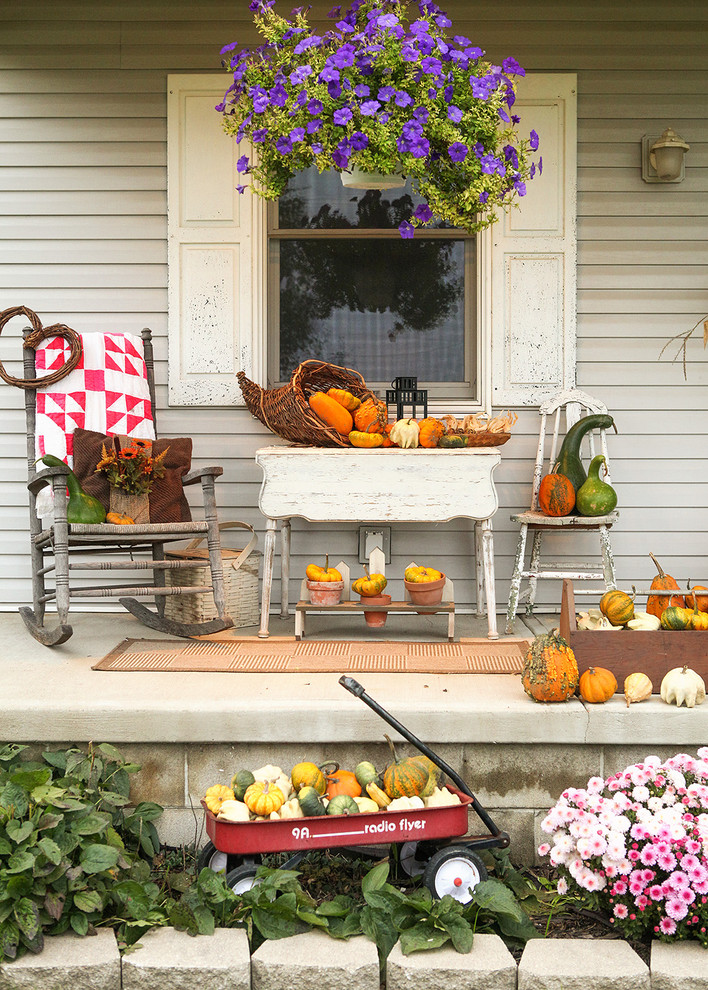 The wagon holding gourds is a cute addition to any porch's fall arrangement.