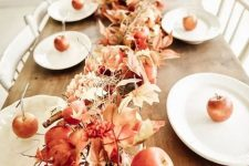 a cool fall table garland of leaves, apples of various sizes and cinnamon sticks is amazing for fall decor