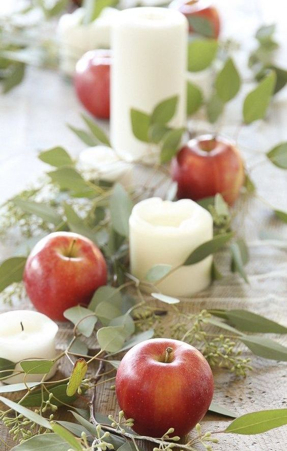 a natural fall garland of eucalyptus, apples and pillar candles is a gorgeous fall decoration to rock