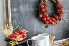 a vine wreath with foliage, red apples and a burlap ribbon is a bright and cool decoration to rock