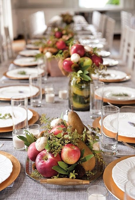 a wedding or party fall centerpiece in a vintage bowl with greenery, pears, apples and mushrooms is lovely and natural