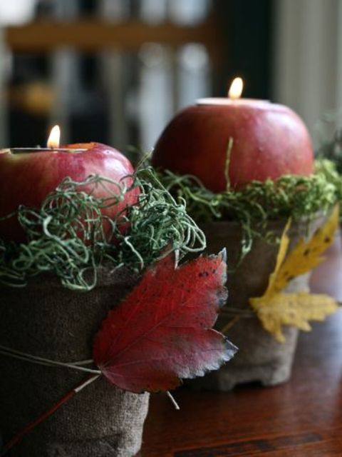 burlap wrapped buckets with yarn, apple candleholders and bright fall leaves for rustic fall decor