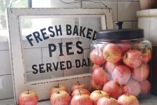 fresh apples in a large glass jar can be not only food but also a pretty farmhouse decorations for a fall space