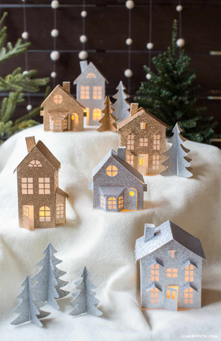 Glitter paper winter village is the ideal DIY project for the Holiday season. Make sure to buy some flickering LED lights to make the village looks awesome at night. (via https:)