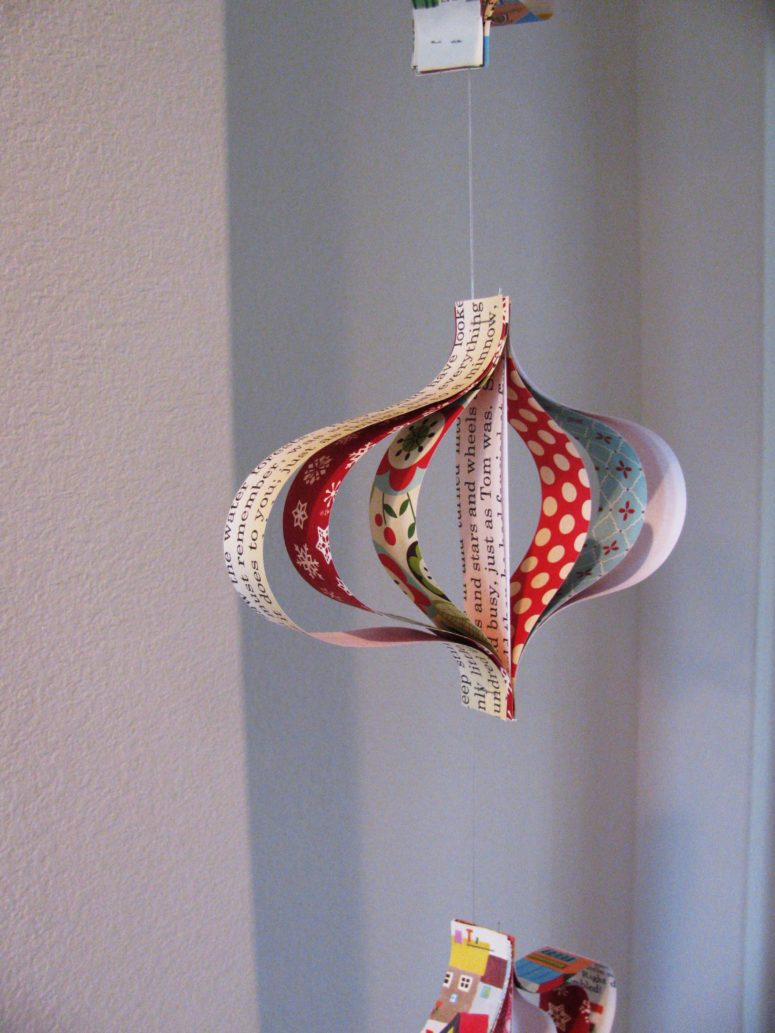 Worn-out book, vintage Christmas music paper, old magazines, and various scrapbooking pages could be recycled into unique, yet simple to make ornaments. (via sweetsweetlife.typepad.com)