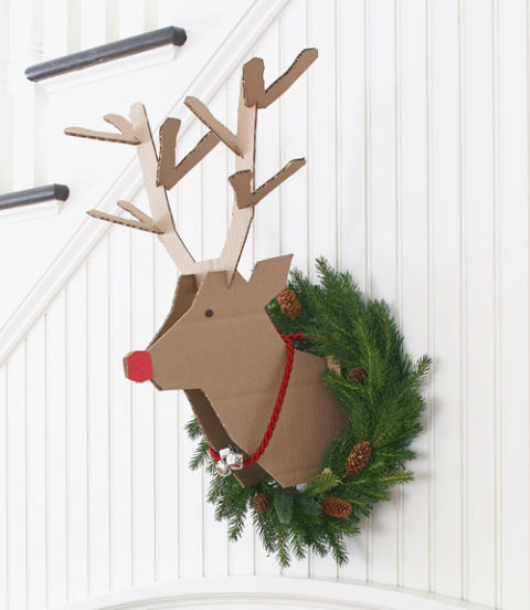 A couple of IKEA cardboard boxes could become this playful reindeer you could hang on any wall. (via www.goodhousekeeping.com)