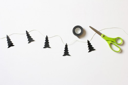 Make this stylish, modern garland using Scandinavian tree pattern and black cardstock. (via www.shelterness.com)