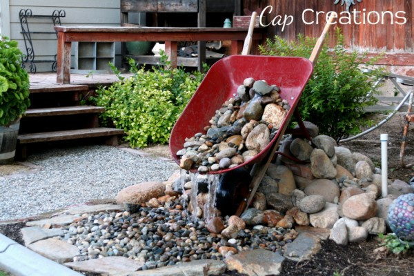 Wheelbarrow garden fountain. It would definitely become a centerpiece of any backyard garden.