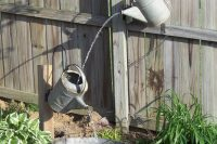 Water jug fountain. It's made of a bunch of galvanized water cans a galvanized water tub.