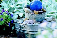 Homemade Glavanized water feature with a blue orb.