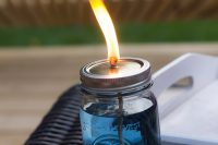 mason jar citronella candles is a charming way to repel mosquitos