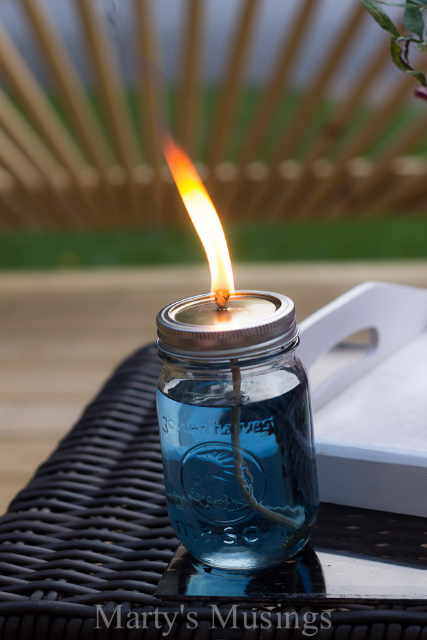 mason jar citronella candles is a charming way to repel mosquitos (via martysmusings)
