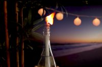 A great way to reuse empty wine or beer bottles (you'll need Tiki replacement wicks (thick cotton rope also works well), Citronella torch fuel, Brass coupling, Rope or twine, Pebbles, Wood glue)