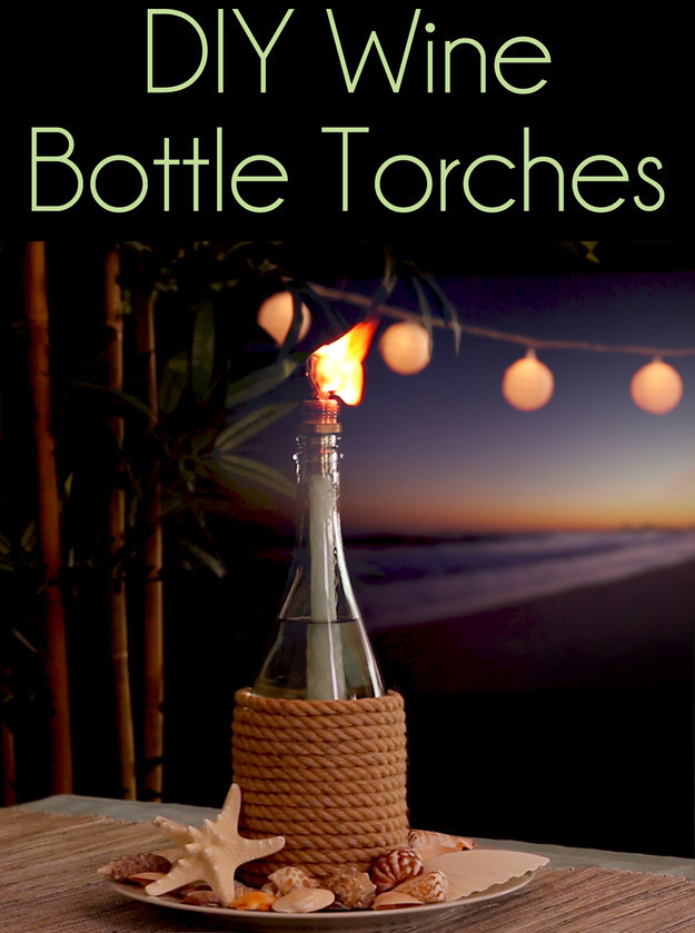 A great way to reuse empty wine or beer bottles (you'll need Tiki replacement wicks (thick cotton rope also works well), Citronella torch fuel, Brass coupling, Rope or twine, Pebbles, Wood glue) (via https:)