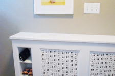 Entryway radiator cover with built-in cubbies