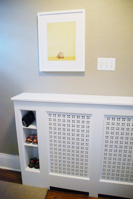 This project would help to hide an ugly yellow radiator and help you to organize your entryway. This cover features several built-in storage cubbies. (via www.ramblingrenovators.ca)