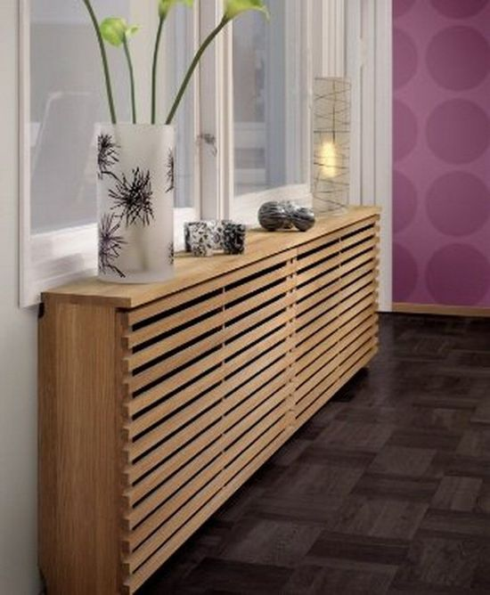If you don't like the look of your radiators then this modern-looking wooden cover is the best solution to hide them. (via lovechicliving.co.uk)