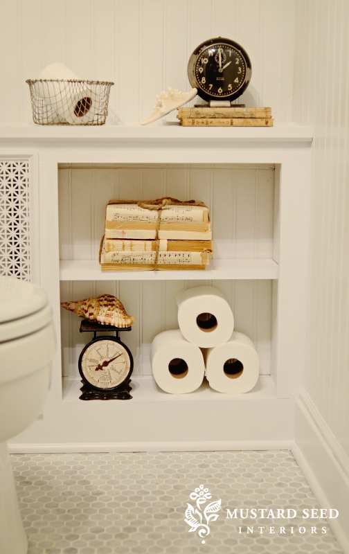This cover features toilet paper storage and display space to make your bathroom's decor more cozy. (via missmustardseed.com)