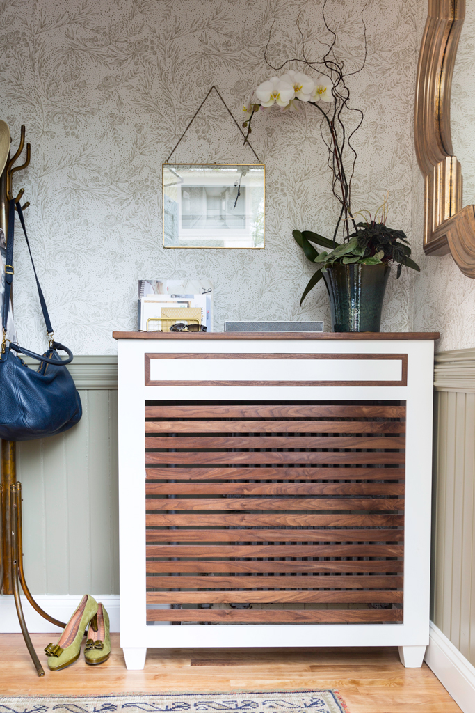 This awesome cover will not only disguise your radiator but become a real part of your decor. The mix of stained wood and white lacquer surfaces always looks gorgeous! (via www.apartmenttherapy.com)