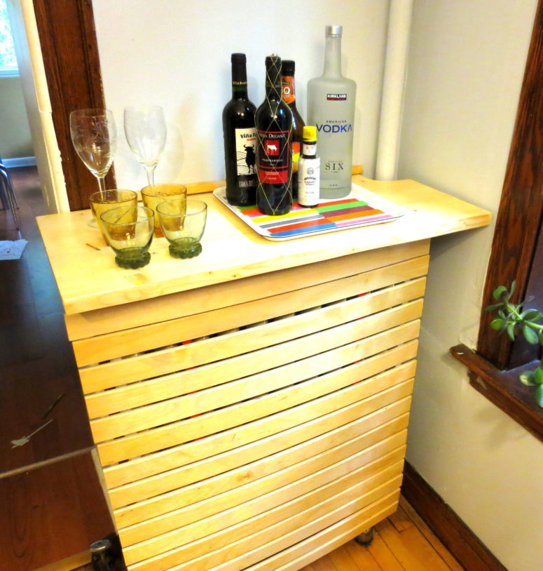 This good looking and practical radiator cover is made of an IKEA Slat Bed Base. Simple and quick way to hide that ugly thing and get yourself an addition table surface. (via https:)