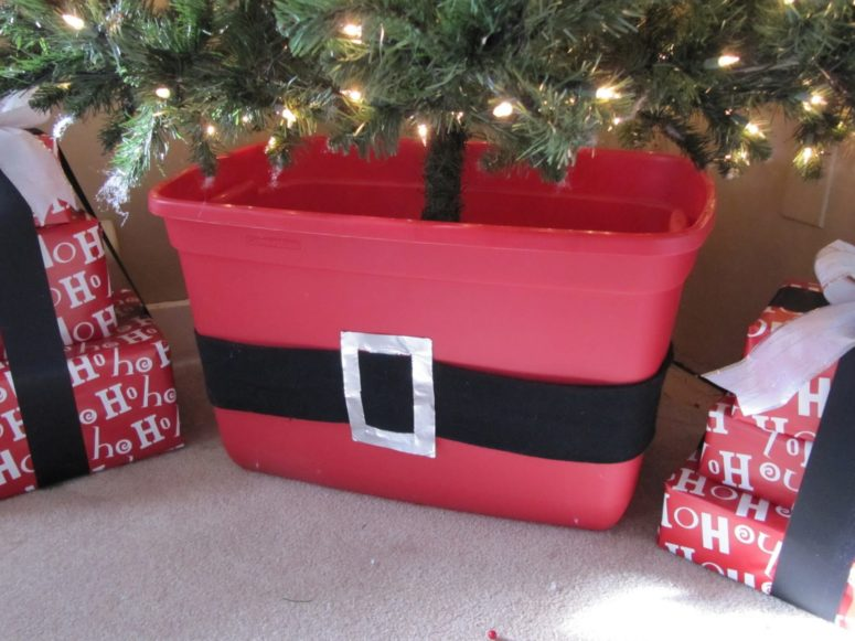 Buy a large red storage box. Put your standard Christmas tree stand inside and wrap the box with a piece of quilt batting to look like snow. (via sewmanyways.blogspot.ru)