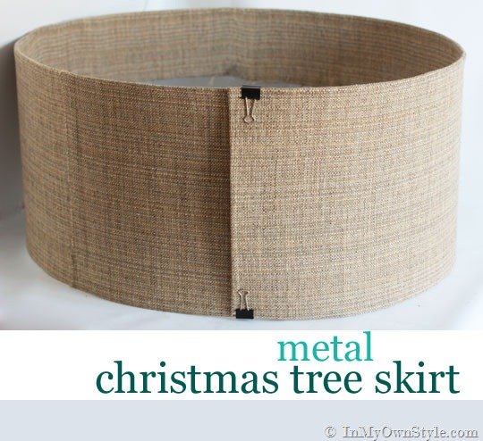 Buy a small roll of metal sheet flashing. Cut it using metal scissors and duct tape along the edges. Apply burlap fabric to it using spray glue.  (via inmyownstyle.com)