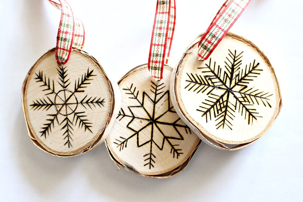 Picture Of diy birch slice ornaments with wood burned design  6