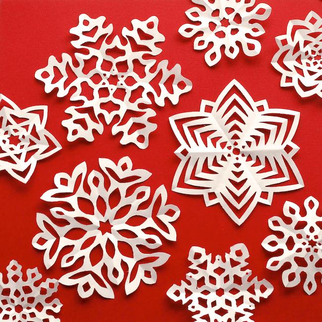 Cut Fold Kirigami Snowflakes (via Omiyageblogs)