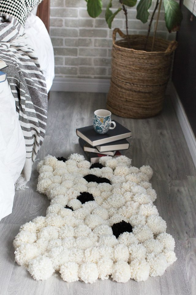 Picture Of diy chic pompom rugs to feel cozy in the winter  11